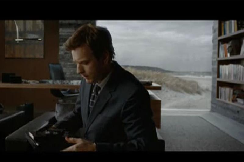 Ewan McGregor in an Island-esque library.